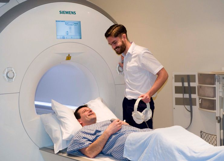 Patient smiling before entering an MRI scanner